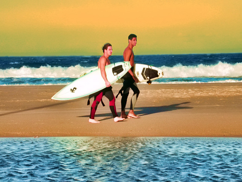 Surfers walking with surfboards.